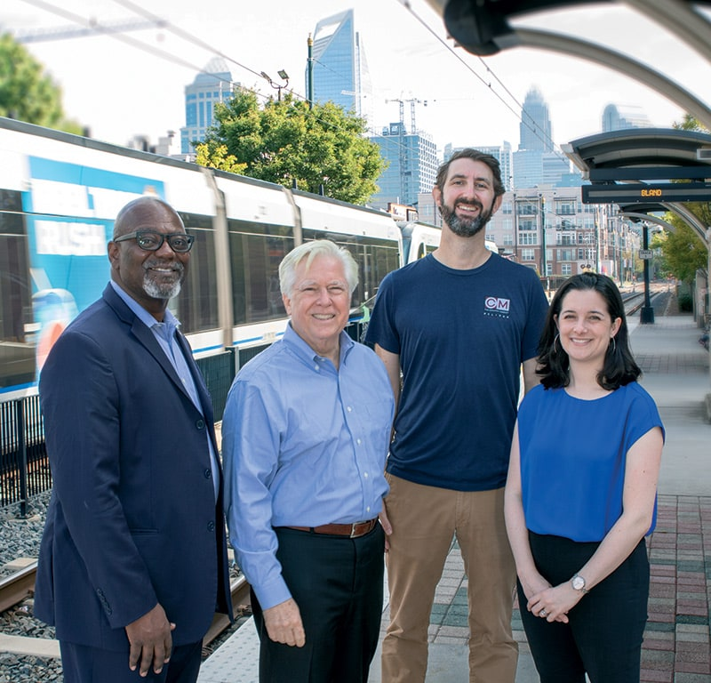 South End's success required contributions from many private investors and public officials. Shown, left to right, are Mecklenburg County Commission Chairman George Dunlap; architect Terry Shook; restaurateur Graham Worth; and neighborhood promoter Megan Gude.